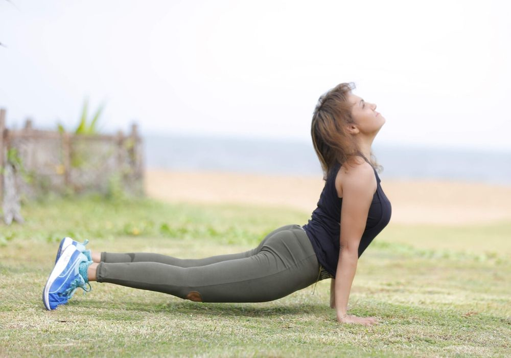 A woman doing bhujangasana at yoga classes in thane as, yoga do wonders to your skin.
