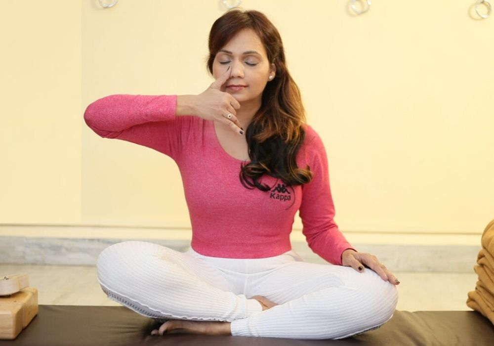 Yoga business coach performing Pranayama in shwet yoga classes in thane