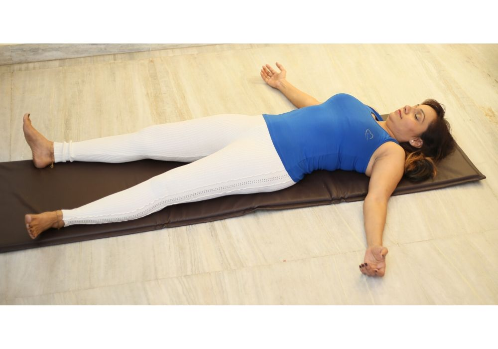 Hatha yoga classes in thane west performing savasana